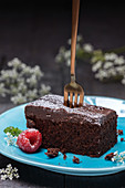 Brownie with powder sugar and raspberries