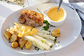 Pork steak with white asparagus and sauce Hollandaise