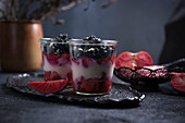 Red Moon apple compote with soya yoghurt and active charcoal sprinkles