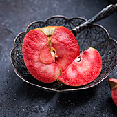 A sliced Red Moon apple