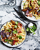 Penne with grilled plums, bacon and basil