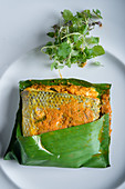 Close up of Spiced Seabass Wrapped in Banana Leaf