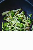 Fried broccoli in a wok