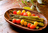 Green asparagus with cherry tomatoes, soy sauce and lemon