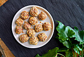 Baked beef balls with cheese and nuts