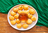 Cheese Puffs, served with honey