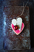 A pink heart-shaped biscuits with a pendant