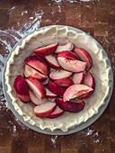 An unbaked peach pie