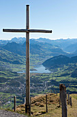 A cross on the summit of Mount Rigi with Lake Lucerne and the Glarus Alps in the background, Lucerne, Switzerland