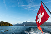 Lake Lucerne with a Swiss flag in the foreground, Lucerne, Switzerland