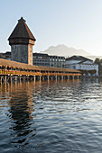 The water tower and the Kappellbrücke over the River Reuss, Lucerne, Switzerland