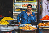 A man selling street food (India)