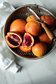 Blood oranges in a colander