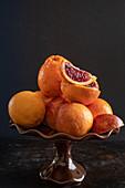 Oranges and blood oranges in a ceramic bowl