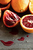 Oranges and blood oranges, partially juiced