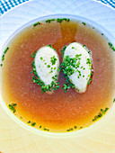Semolina dumpling soup with chives