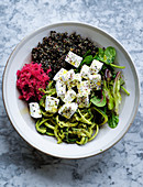 Vegan Buddha with 'feta', black quinoa and pickled pink sauerkraut