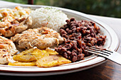 Casado (chicken with beans, rice and plantains, Costa Rica)