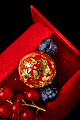 Buche de Noel with berries and gold leaf