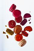Various different coloured macaroons, some broken