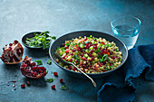 Tabouli salad with bulgur wheat, tomatoes, cucumber, pomegranate, mint and parsley