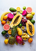 Tropical fruits pattern with mango, papaya, pitahaya, passion fruit, grapes, limes and pineapples