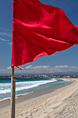 Red flag on Pacific Ocean beach, Mexico
