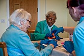 Care home residents making cakes