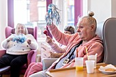 Care home residents in activity session