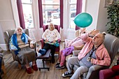 Care home residents in communal activity session