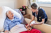 Male care home resident blood pressure test