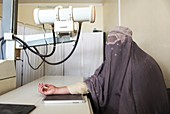 Woman's arm being x-rayed, Afghanistan