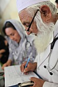 Doctor taking notes, Afghanistan