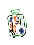 Airport case with various items, X-ray