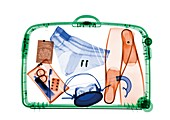 Suitcase with snorkelling equipment, X-ray