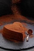 Heart-shaped cheesecake with cocoa topping