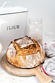 Loaf of sourdough bread on a bread board