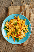 Lentil fusilli with turmeric and chilli oil and pears