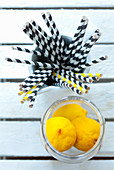 Straws and lemons as utensils and ingredients for drinks