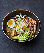 Curry ramen with pork escalope and beansprouts