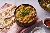 Indian red lentil curry soup dal with rice naan (vegan)