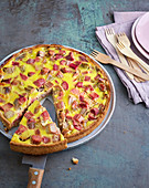 Moist rhubarb cake with an egg glaze