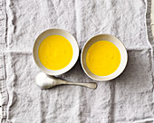 Vegan pumpkin soup with orange juice