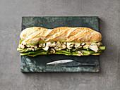 Vegan baguette with mushrooms, asparagus and beans