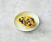 Stuffed papaya with blueberries and lime