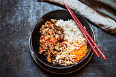 Sticky sesame beef with rice and vegetables