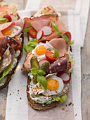 Strammer Elmar (a slice of bread topped with ham and fried quail's eggs)