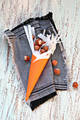 An orange cone filled with hazelnuts