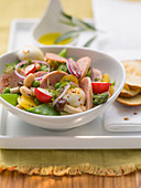 Sausage salad with radishes and beans