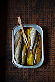 Sardines in a tin with a wooden fork